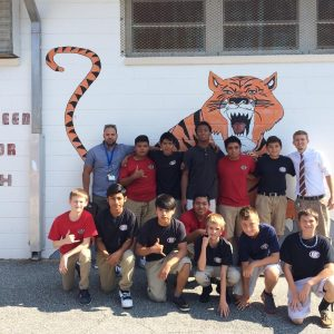 Kathleen Middle School Sports Team in front of the School Logo, a Tiger.